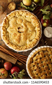 Homemade apple pies on a rustic background