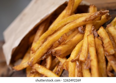 Homemade authentic healthy oil free fresh delicious golden real organic potato french fries wedges with natural skins with salt, pepper, mayonnaise, ketchup sauce. Tasty vegetarian appetizer meal