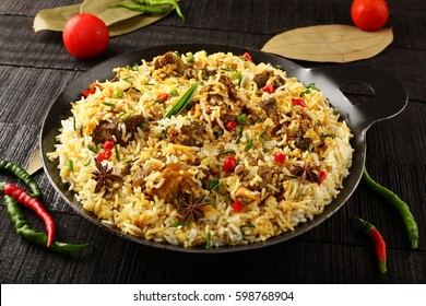 Homemade Authentic Indian mutton biriyani served in iron cookware.