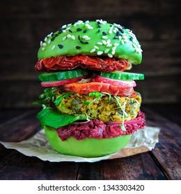 Homemade avocado burger with quinoa, sweet potato, sun dried tomatoes and beet pesto sauce