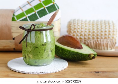 Homemade avocado mask in a glass jar. Prepared from mashed avocado and olive oil. Diy cosmetics.