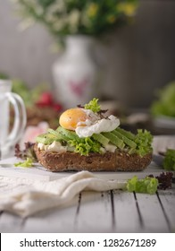 Homemade avocado poached egg sandwich wholegrain bread, food photography
