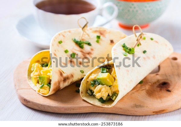 Homemade avocado scrambled egg wraps for healthy breakfast