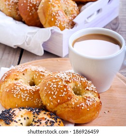 Homemade bagels, and cup of coffee, square image