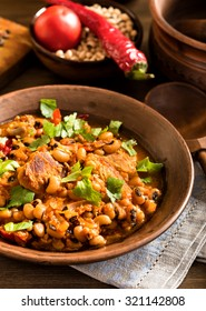 Homemade baked beans with pork rustic style