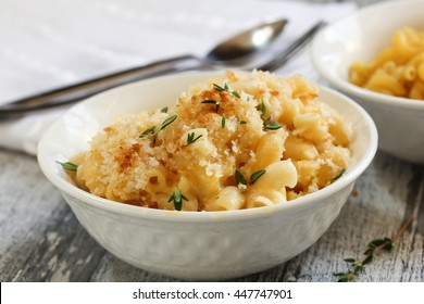 Homemade baked Mac and cheese served in a bowl, selective focus