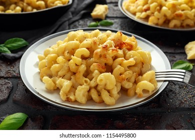 Homemade baked macaroni and cheese with cheddar served on plate