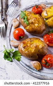 Homemade baked potato with bacon and vegetables. Selective focus.
