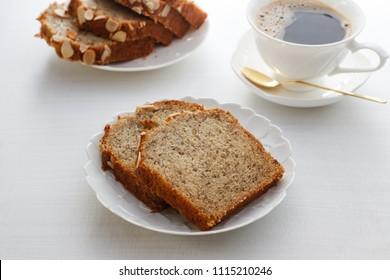 homemade banana bread, pound of banana cake. sliced of banana bread with hot coffee.