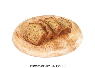 Homemade banana bread sliced on white background