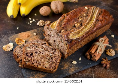 Homemade banana bread with walnut and cinnamon on a stone background