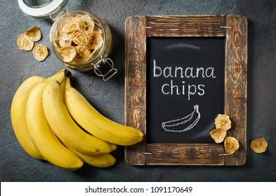 Homemade banana chips in a glass jar. Banana dessert