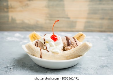 Homemade banana split with on the rustic background. Selective focus.