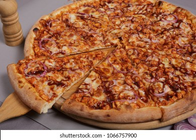 Homemade barbecue chicken pizza with onion and special sauce. Pizza with ingredients to cook it. Delicious Italian food for lunch or dinner.