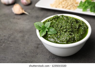 Homemade basil pesto sauce in bowl on table. Space for text