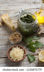 Homemade basil pesto sauce with fresh ingredients.