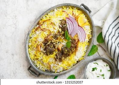 Homemade Beef Biryani served with Raita yogurt dip, overhead view