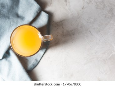 Homemade Beef Bone Broth in Glasses on a gray concrete background. Bones contain collagen, which provides the body with amino acids, which are the building blocks of proteins, top view with copy space
