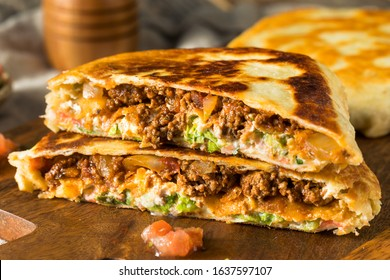 Homemade Beef Crunchwrap Quesadilla with Cheese Lettuce and Tomato