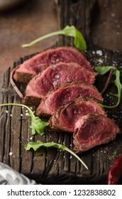 Homemade Beef Steak rare, pepper and salt and little salad