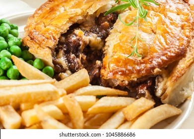 Homemade beef stew pie with french fries. Meat in puff pastry