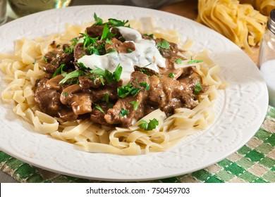 Homemade beef Stroganoff with mushrooms and tagliatelle pasta