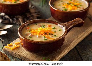 Homemade Beer Cheese Soup with Chives and Bread