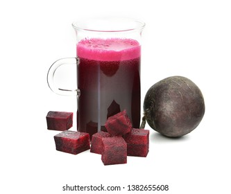 homemade beetroot juice extract with whole beetroot cut in cubes isolated on white background