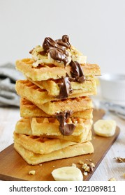Homemade Belgian Waffles with Chocolate Cream Sauce Banana Walnuts  Wooden Desk Cutting Board