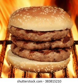 Homemade Big Hamburger On The Hot Flaming BBQ Grill, Close Up, Front  View, Cookout Food For Outdoor Party Or Picnic
