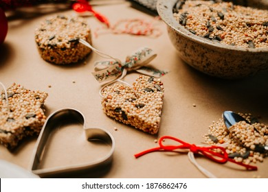 Homemade Birdseed Christmas Ornaments tied with Ribbon - Shutterstock ID 1876862476