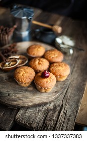 Home-made biscuit cakes. A simple cherry muffin on top. A set of muffins with dried paradise apple.