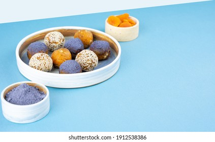 Homemade blue matcha butterfly pea tea powder energy balls in a ceramic bowl on a top view background, healthy sweets. Concept vegeterian diet sweet brain sustainable food. Copy space
