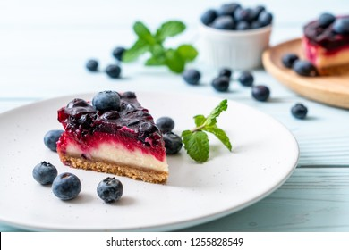 homemade blueberry cheese cake on wood background