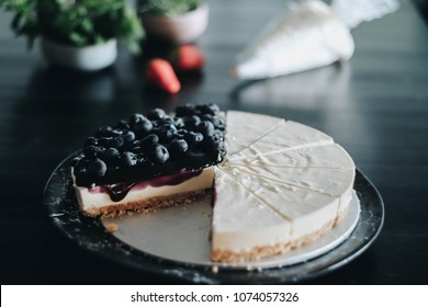 Homemade Blueberry Cheese Pie on Black Background