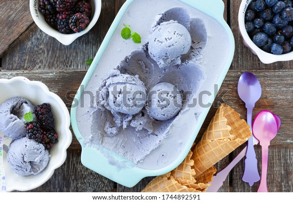 Homemade blueberry ice cream with waffle cones