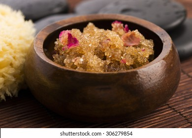 Homemade body peeling with sugar, olive oil and rose petal
