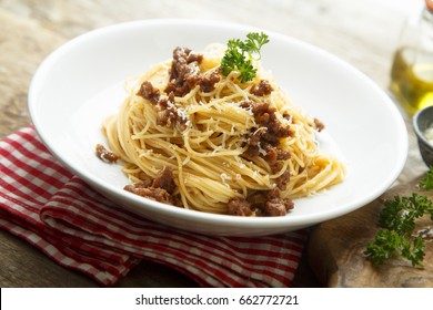 Homemade Bolognese pasta with grated cheese