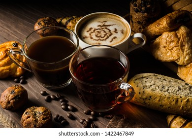 homemade bread consists of slice and bun, French bread, muffins and croissants with coffee beans in hemp bag and hot tea and coffee placed on brown wood table, for use as posters and advertising media