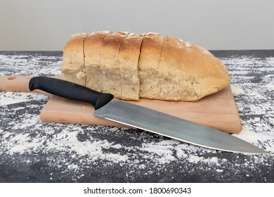 Homemade bread cut next to the knife
