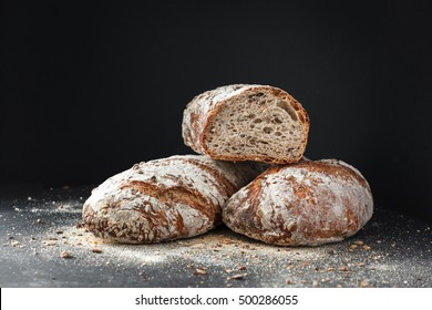 Homemade bread loaf on rustic dark background