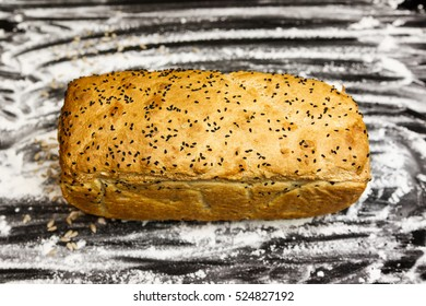 Homemade bread on a flour background