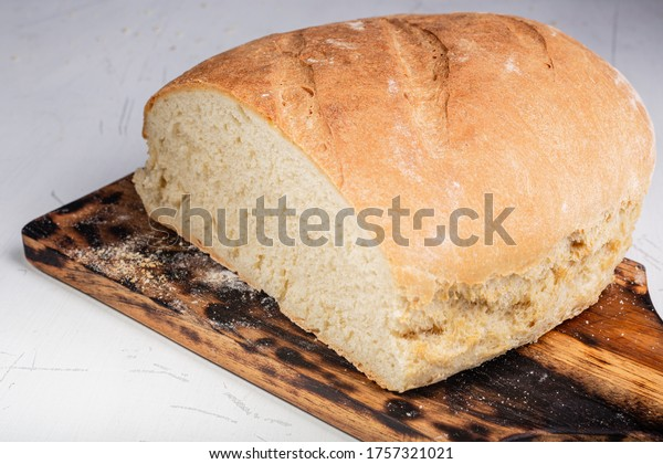 Homemade bread. Homemade pastries. Made from wheat flour. Tasty and healthy. Fresh bread on the kitchen table. For vegetarians.