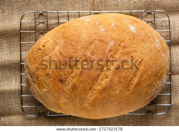 Homemade bread. Photo from above. Homemade pastries. Made from wheat flour. Tasty and healthy. Fresh bread on the kitchen table. For vegetarians.