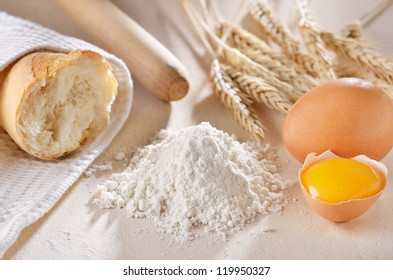 Homemade bread scene with wheat, flour and eggs