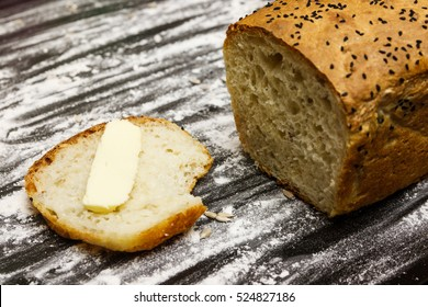 Homemade bread with a slice and butter