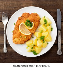 Homemade breaded german weiner schnitzel with potatoes.