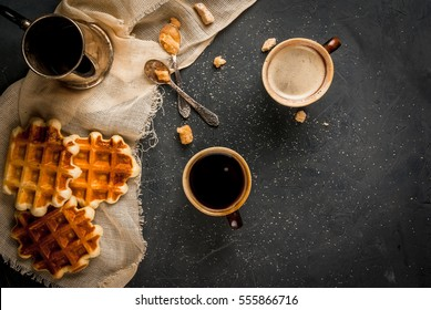 Homemade breakfast, a cozy kitchen, stone table. Viennese waffles, two cups of coffee, coffee, vintage spoon with brown sugar, Top view, copy space