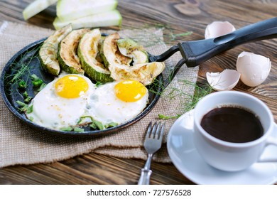 Home-made Breakfast - scrambled eggs, zucchini slices and black coffee. Shallow DOF