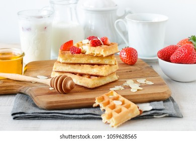 Homemade breakfast with waffles and strawberry